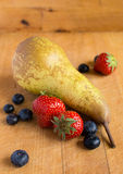 Blueberries, strawberry and pear Stock Photos