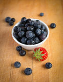 Blueberries and strawberry Stock Images