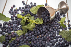 Blueberries on the table. Blueberries scattered on the wooden table Royalty Free Stock Photo