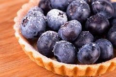 Blueberries tart on the wooden board Stock Image