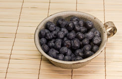 Blueberries in a tin cup Royalty Free Stock Images