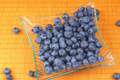 Blueberries in a transparent glass plate Stock Photography