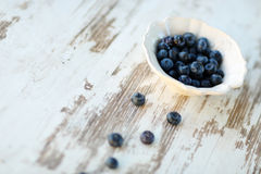 Blueberries in vintage plate Royalty Free Stock Photo