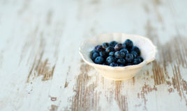 Blueberries in vintage plate Royalty Free Stock Photography