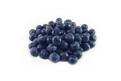 Blueberries with water drops. A handful of blueberries with water drops, isolated, closeup Stock Photography
