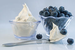 Blueberries and whipped cream stock images