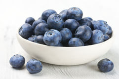 Blueberries in white bowl Stock Photography