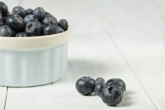 Blueberries in white bowl. Image of blueberries in white bowl Stock Photos