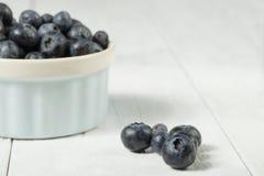 Blueberries in white bowl Stock Photos