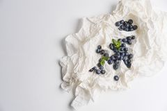 Blueberries in white paper with mint Stock Photos
