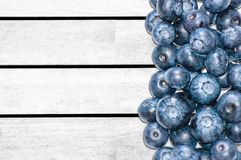 Blueberries on a white wooden table Royalty Free Stock Image