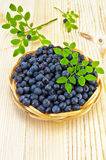 Blueberries in a wicker tray on a blackboard Royalty Free Stock Photo