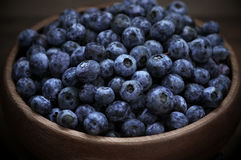 Blueberries in wood bowl Royalty Free Stock Photo