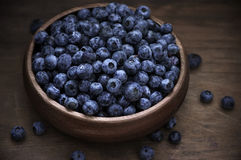 Blueberries in wood bowl Royalty Free Stock Photography