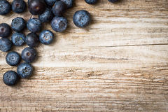Blueberries on wooden background. Stock Photos