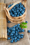 Blueberries on a wooden background. Ripe blueberries on wooden background royalty free stock image
