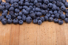 Blueberries on wooden background Royalty Free Stock Photo