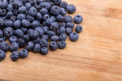 Blueberries on wooden background Stock Photography
