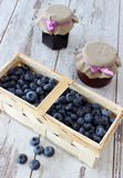 Blueberries in wooden basket Royalty Free Stock Images