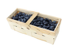 Blueberries in wooden basket isolated on white Stock Image