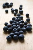 Blueberries on a wooden block Stock Photos