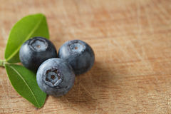 Blueberries on wooden. Blueberry contain antioxidant organic useful healthy and nutrition. Stock Image