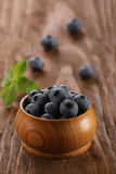 Blueberries in a wooden bowl Royalty Free Stock Images