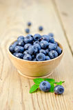 Blueberries in a wooden bowl on the board Stock Photography