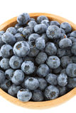 Blueberries in a wooden bowl closeup. Stock Image