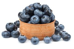 blueberries in wooden bowl isolated on white background Stock Photography