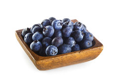Blueberries in wooden bowl stock images