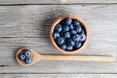 Blueberries on a wooden bowl, spoon Stock Photos