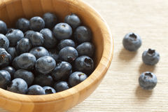 Blueberries in a wooden bowl Stock Photos