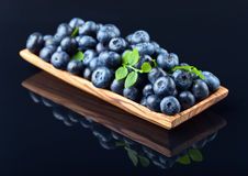 Blueberries in wooden dish Stock Photos