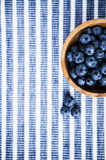 Blueberries on the wooden plate Stock Photography