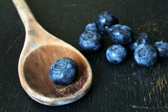 Blueberries and wooden spoon Royalty Free Stock Photography