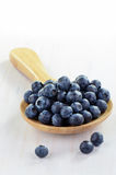 Blueberries in wooden spoon Stock Photos