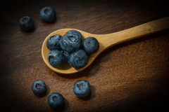 Blueberries on a Wooden Spoon Stock Photos