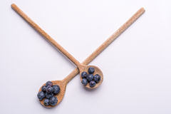 Blueberries on wooden spoon on white background Stock Images