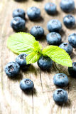 Blueberries on wooden table closeup Royalty Free Stock Images