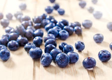 Blueberries on the wooden table Stock Images