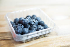 Blueberries on wooden table. Stock Photo