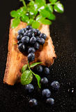 Blueberries in wooden tub on a black surface Stock Photo