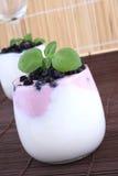 Blueberries in yogurt Royalty Free Stock Image