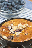 Blueberry almond claufoutis in a cast iron pan paleo diet stock images