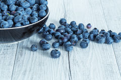 Blueberry antioxidant organic superfood in a bowl on table, concept for healthy eating and nutrition. Freshly picked blueberries. Bilberry on wooden Background stock images