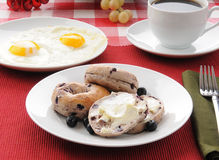 Blueberry Bagles with eggs and coffee Stock Photo
