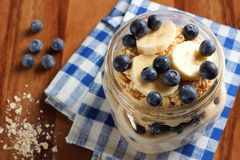Blueberry and banana breakfast oatmeal in mason jar Royalty Free Stock Images