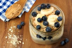 Blueberry and banana breakfast overnight oatmeal in mason jar Royalty Free Stock Photo