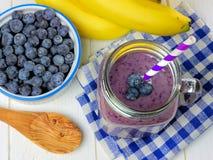 Blueberry, banana smoothie table scene Stock Photos